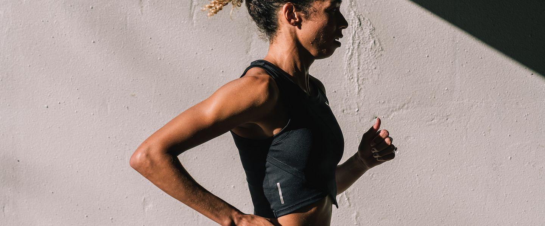 Professional runner Aisha Praught Leer runs down a stret