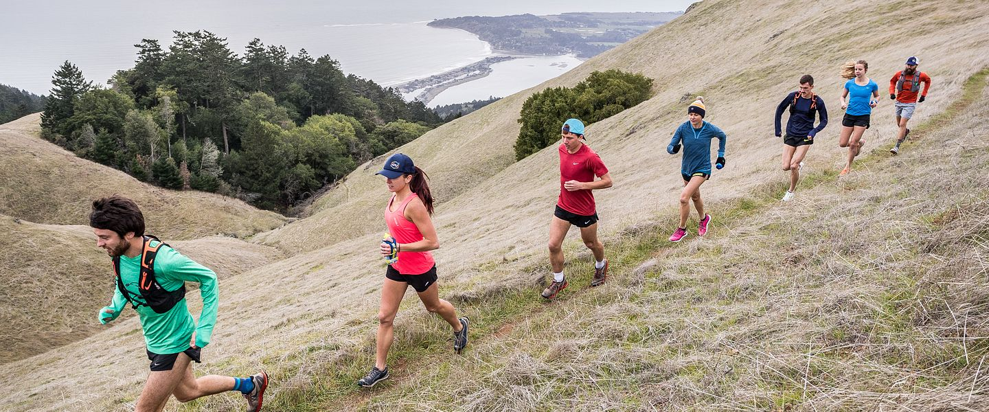 Group of people trail running on a ridge