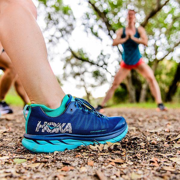 A person wearing a HOKA running shoe