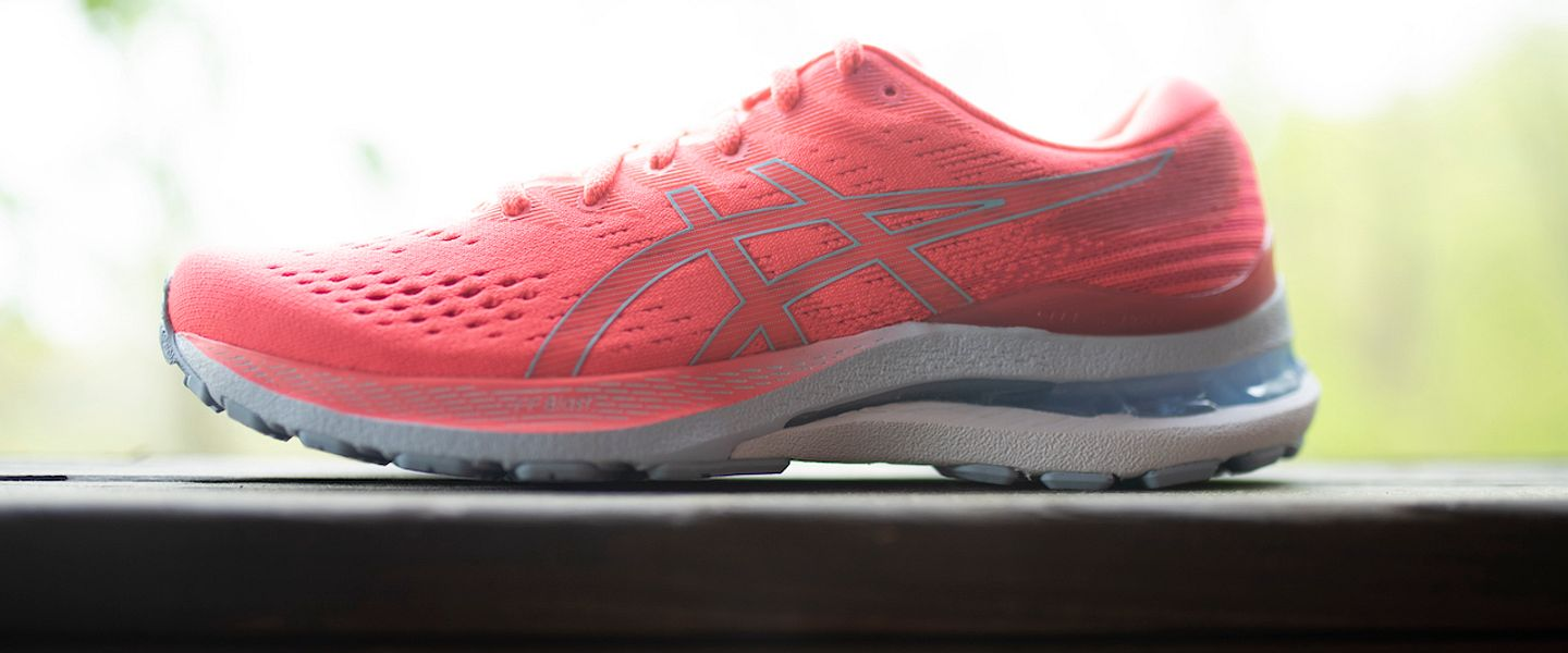 Women's Kayano 28 in bright coral pink.