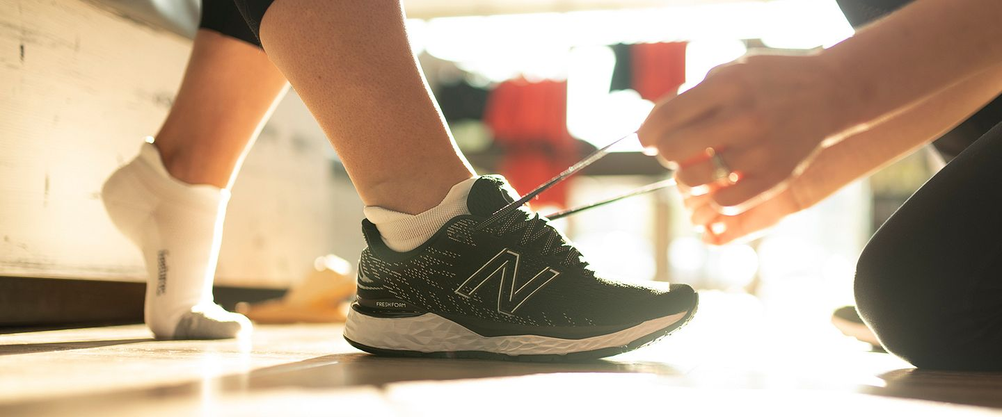 A pair of shoes gets laced up at Fleet Feet