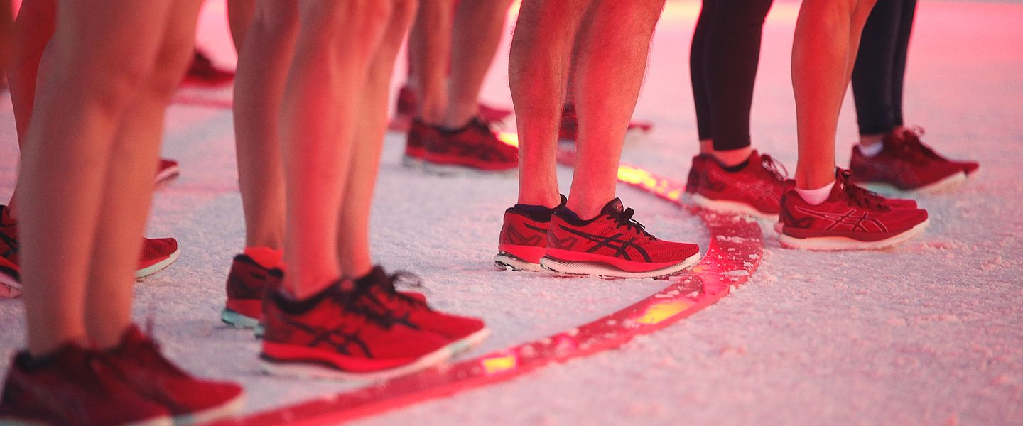 Runners wearing the ASICS GlideRide line up for the start of a race at an event put on by ASICS