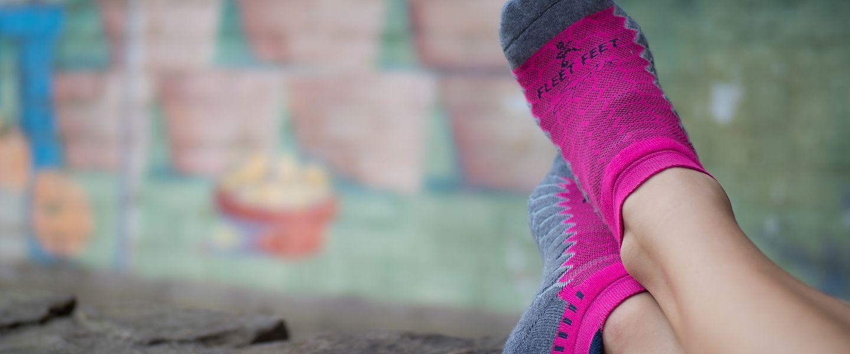Person wearing pink Balega socks