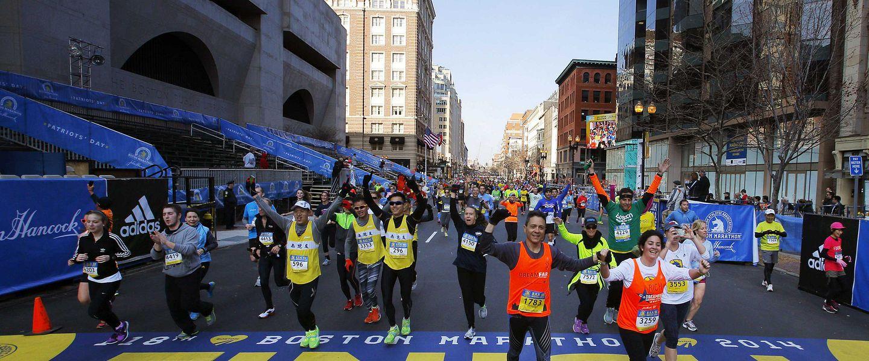 Runners crossing the finish line of the 2014 Boston Marathon