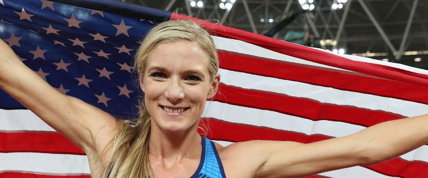 Professional runner Emma Coburn poses for a photo with the American flag