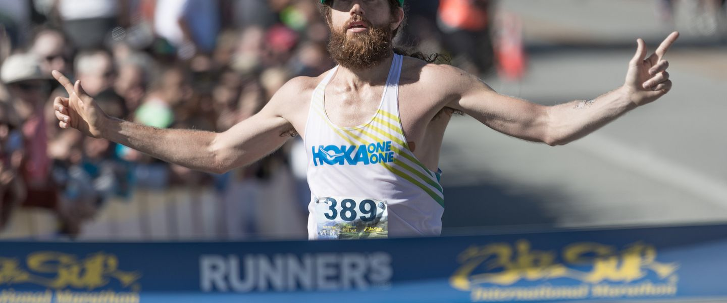 Professional runner Mike Wardian finishing a race