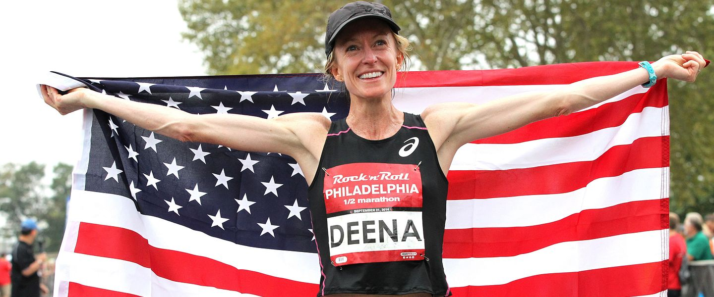 Elite runner Deena Kastor poses with an American flag after a race