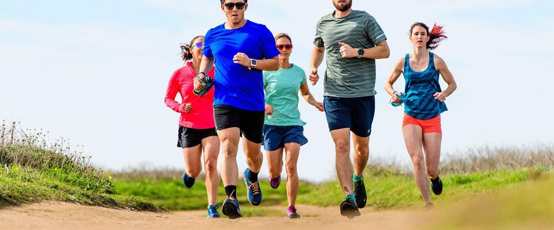 A group of runners running through the grass