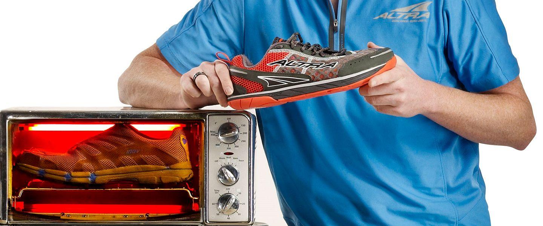 A man holding an Altra running shoe