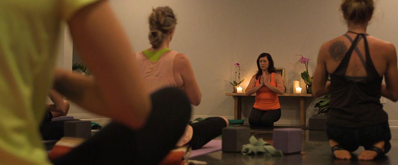 Women doing yoga in a class