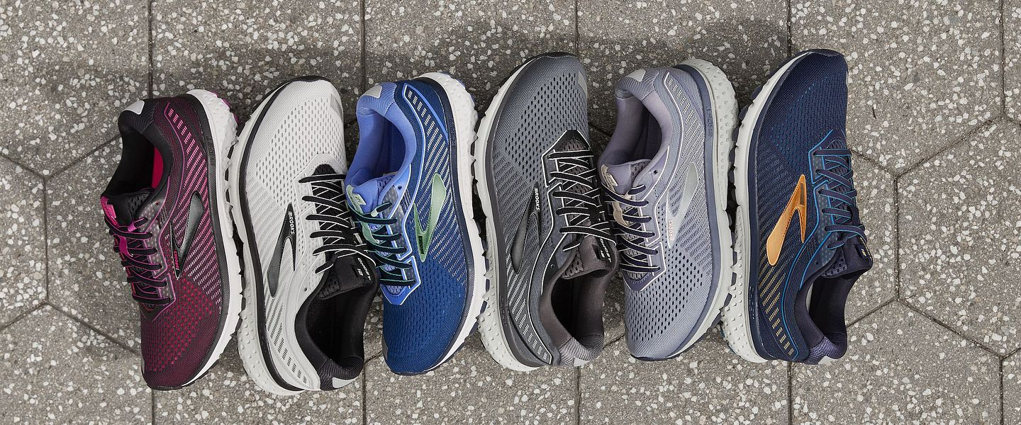 An array of Brooks Ghost 12 running shoes on the ground