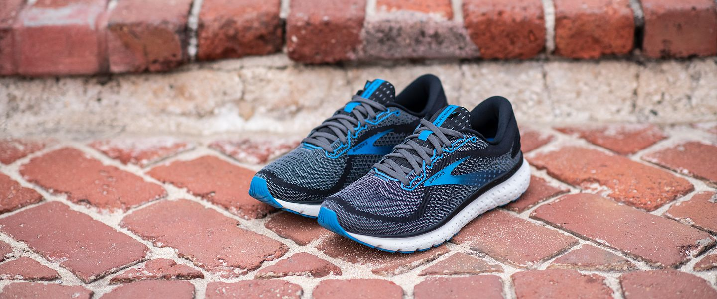 A pair of men's Brooks Glycerin 18 running shoes on a brick stair
