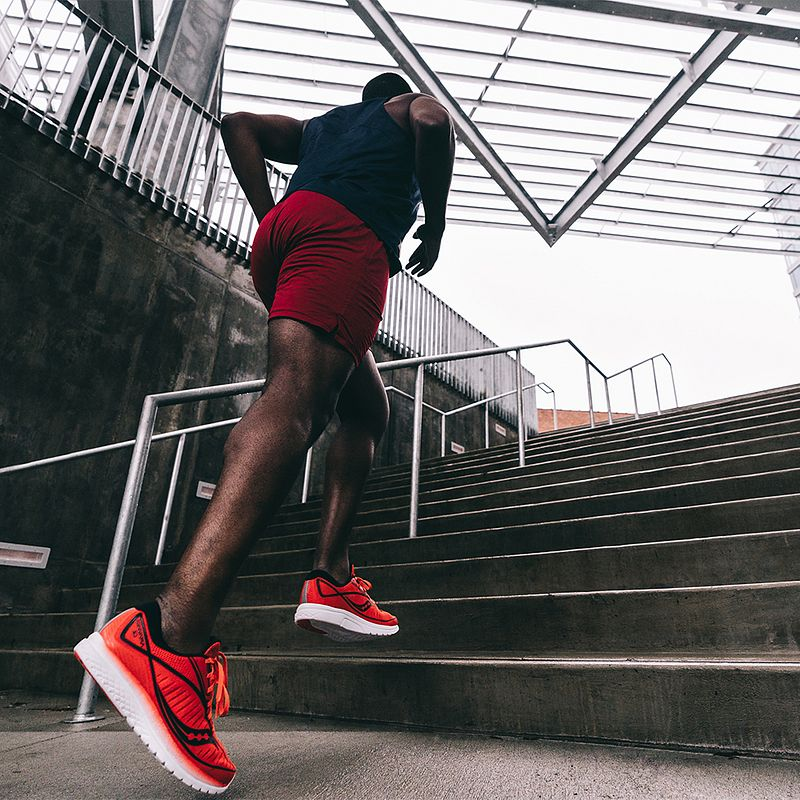 A runner wears exclusive Tracksmith x Fleet Feet apparel for Spring 2019