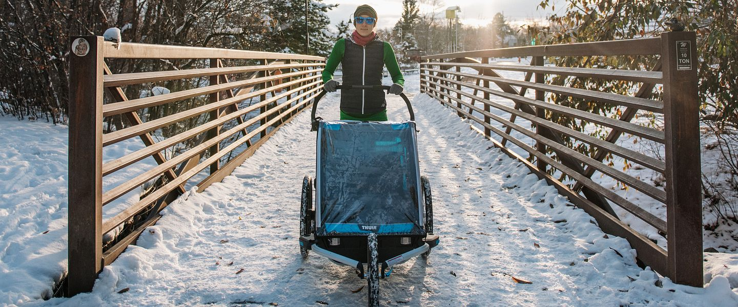 Lauren Arnold runs with a stroller in the snow