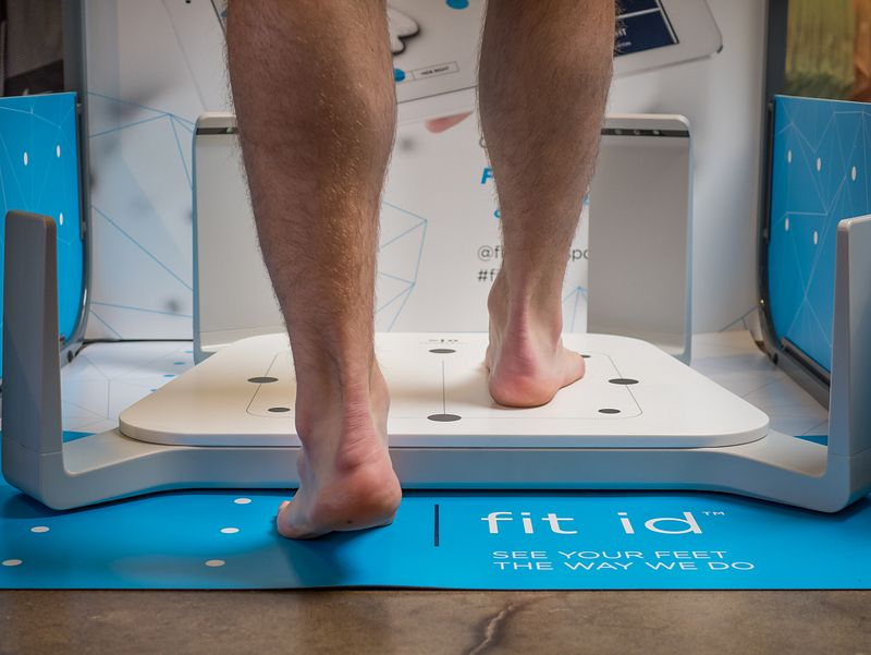 A person stepping on Fleet Feet's fit id 3-D scanner