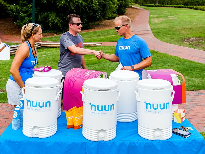 Race volunteers preparing water for runners