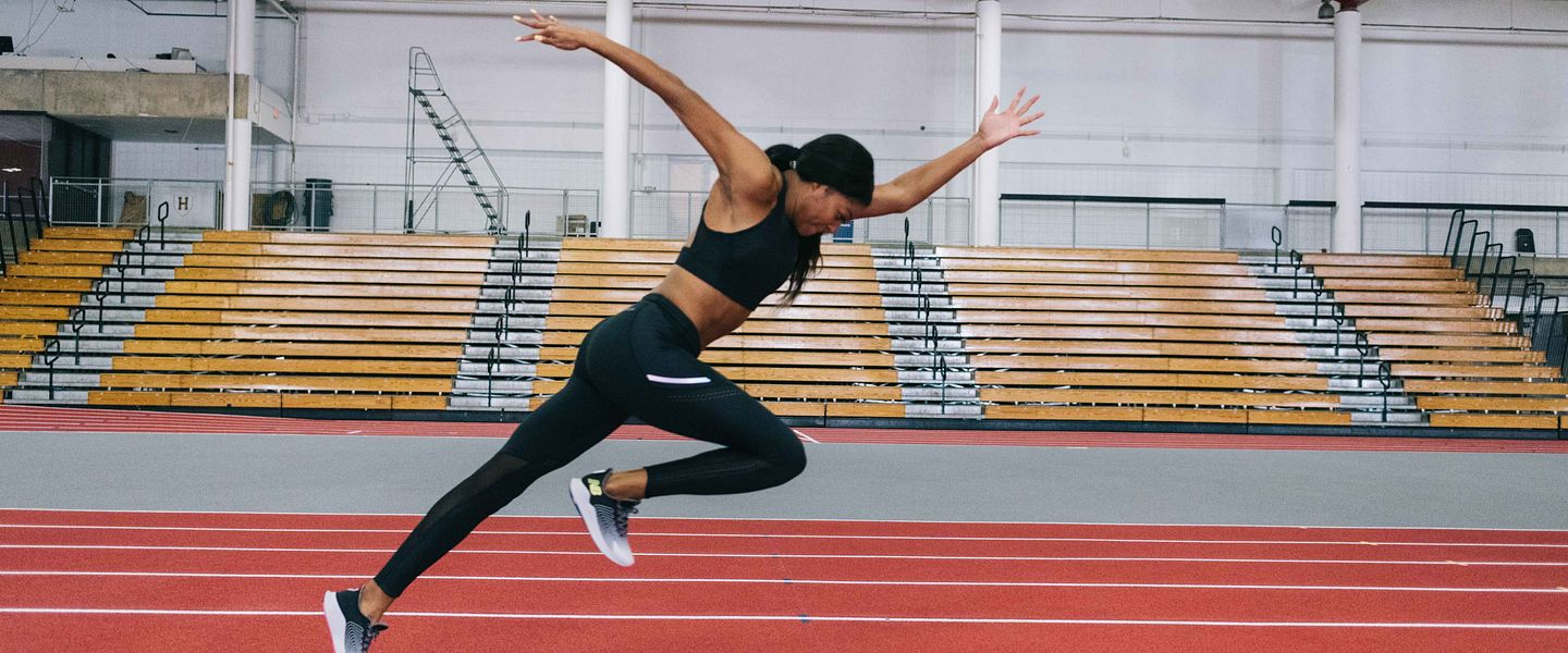 New Balance athlete Gabby Thomas runs on a track after signing a professional contract