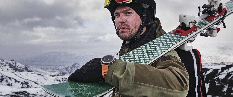 A skier wearing the Garmin Fenix 6 GPS watch
