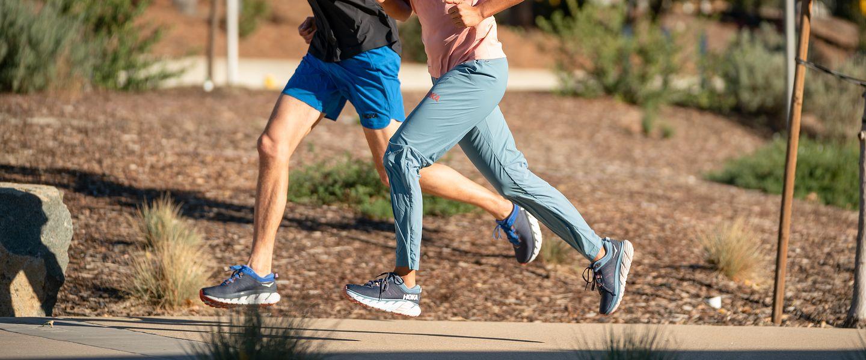 A man and woman running the the HOKA Gaviota 3 shoes
