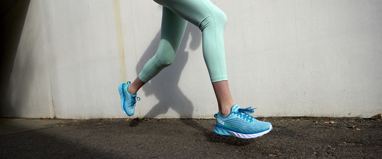 A woman wearing the HOKA ONE ONE Arahi 4 running shoe