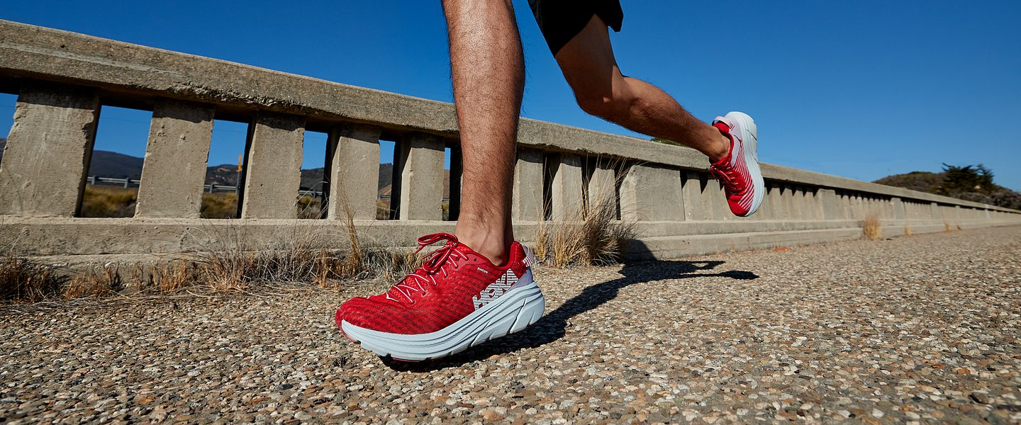 A runner wears the new HOKA Rincon running shoe