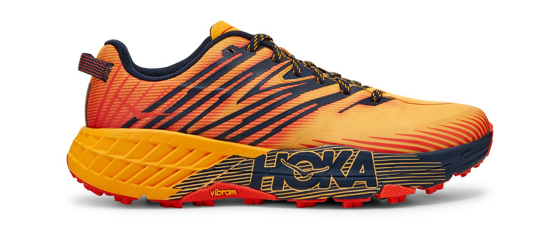 A product photo of the HOKA ONE ONE Speedgoat 4 in orange