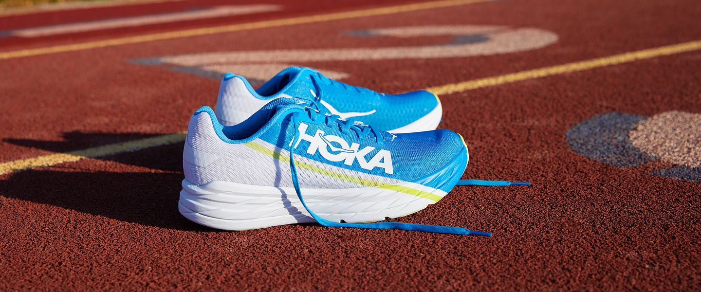 A pair of the HOKA Rocket X running shoes on a track