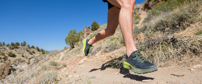 A runner wears the HOKA Speedgoat 3 trail running shoe