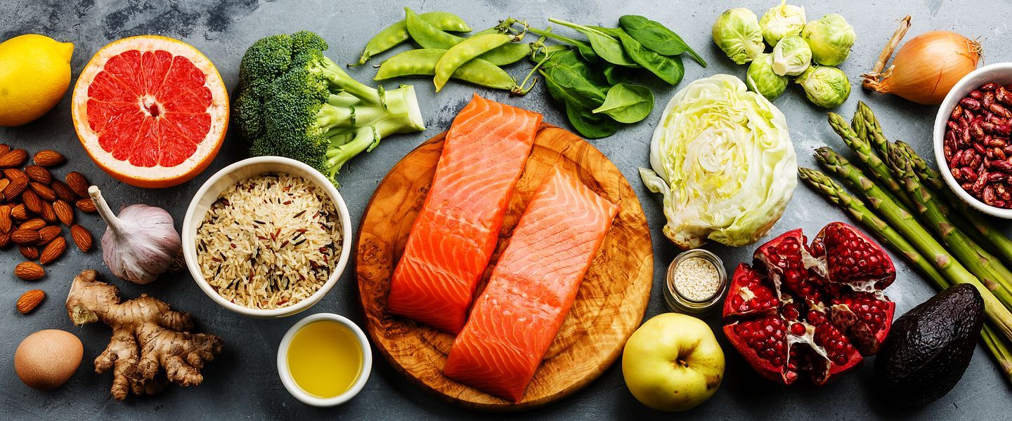 An array of healthy food, including vegetables, fruits and fish