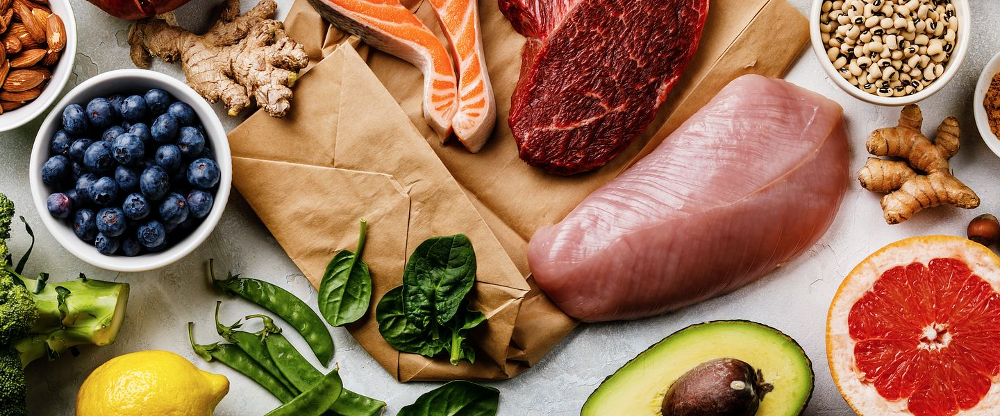 An array of healthy foods, including fish, lean meat, fruits and vegetables