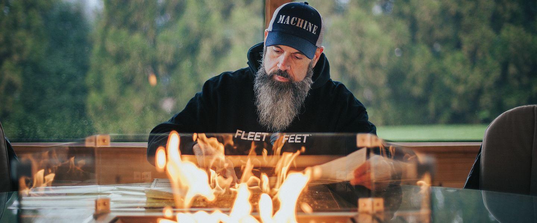 Fleet Feet manager Joe Randene looks at a map before a trail run