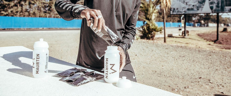 A runner mixes a Maurten hydrogel drink