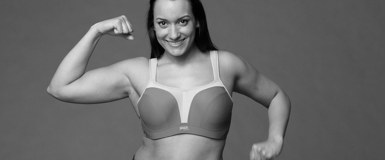 A woman poses while modeling a Panache sports bra