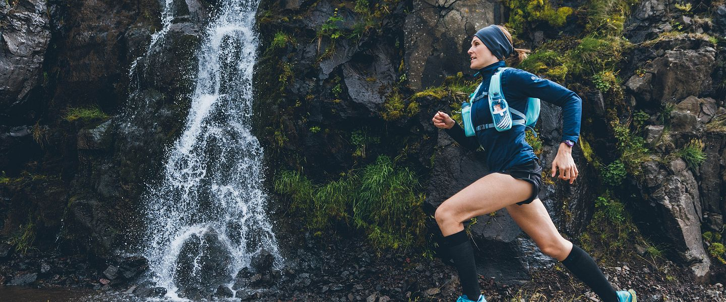 A runner wears a Nathan hydration pack