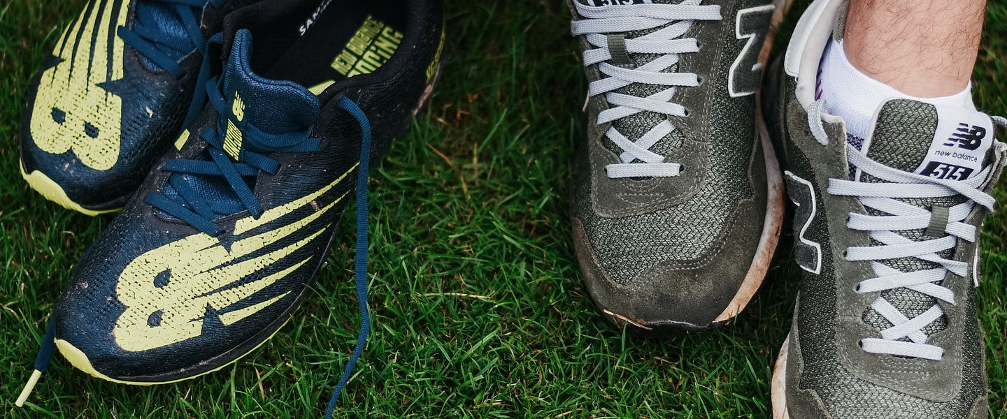 A runner changes into a pair of New Balance cross country spikes