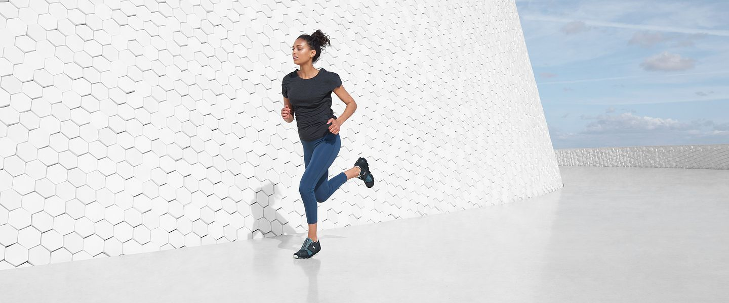 A woman runs in the new On Cloudstratus