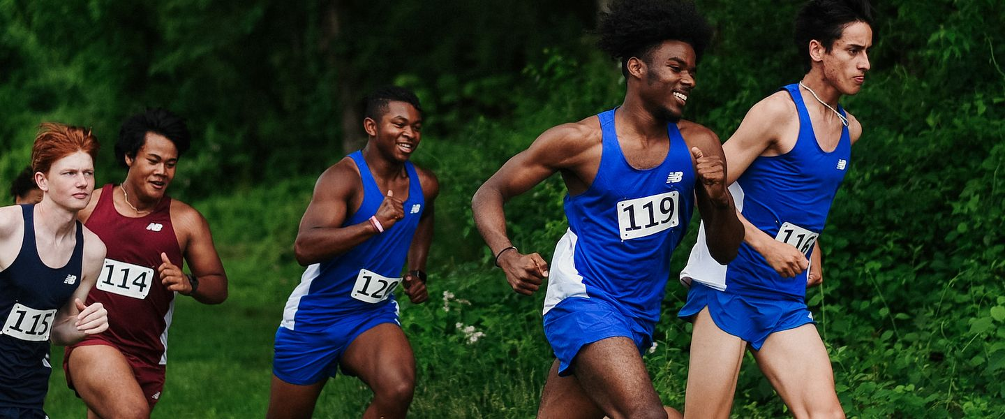 Cross Country runners race up a hill