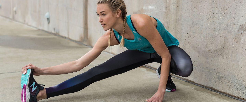 A woman stretches before a run