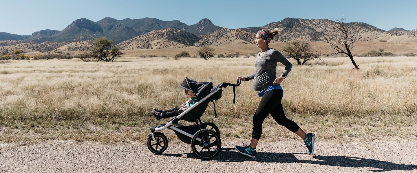 Arizona mom Brigid Pickett pushes a stroller while she runs during her pregnancy