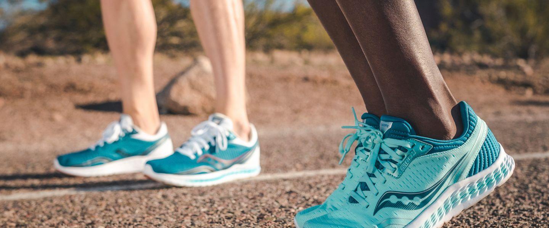 Two runners wearing the Saucony Kinvara 11 running shoe