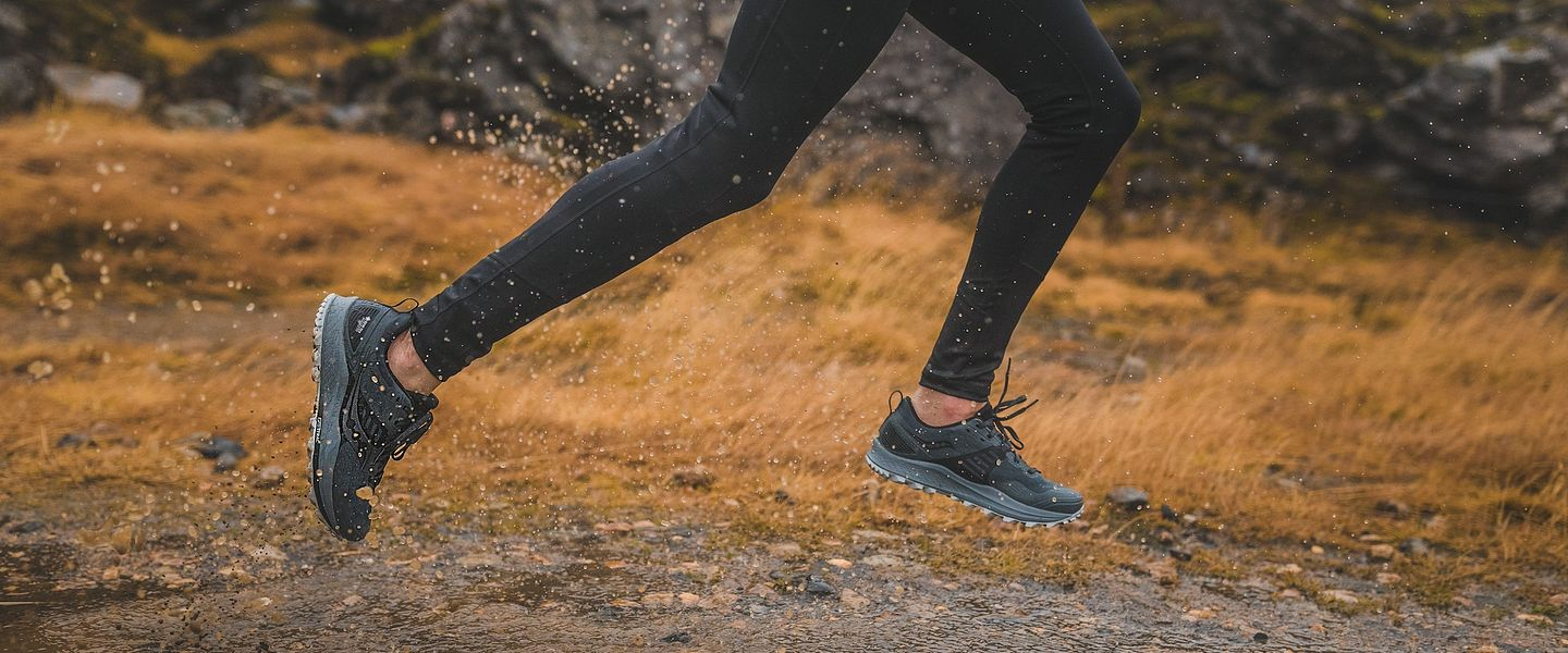 A person running in the Saucony Peregrine 10 trail running shoe