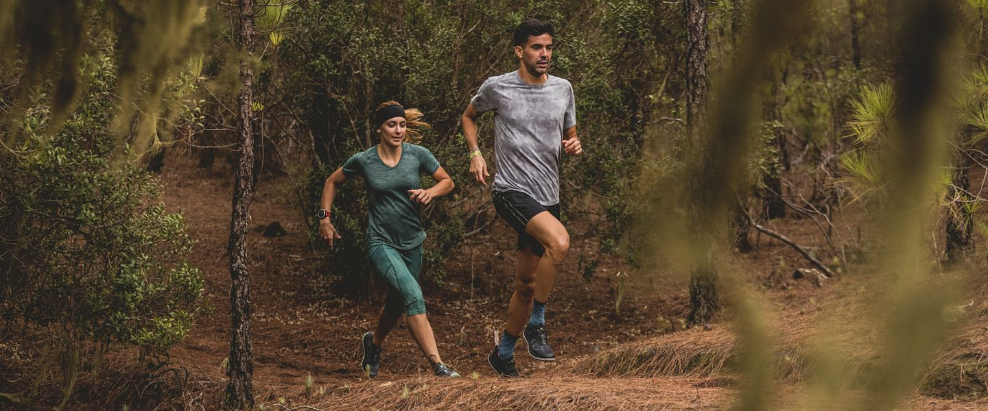 Two runners wear the Saucony Switchback ISO shoes during a trail run