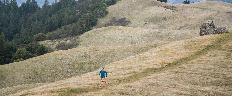 Ultrarunner and GU Energy Labs VP Magda Boulet runs on a trail