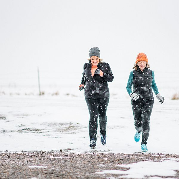 Two women on a snowy track during the winter