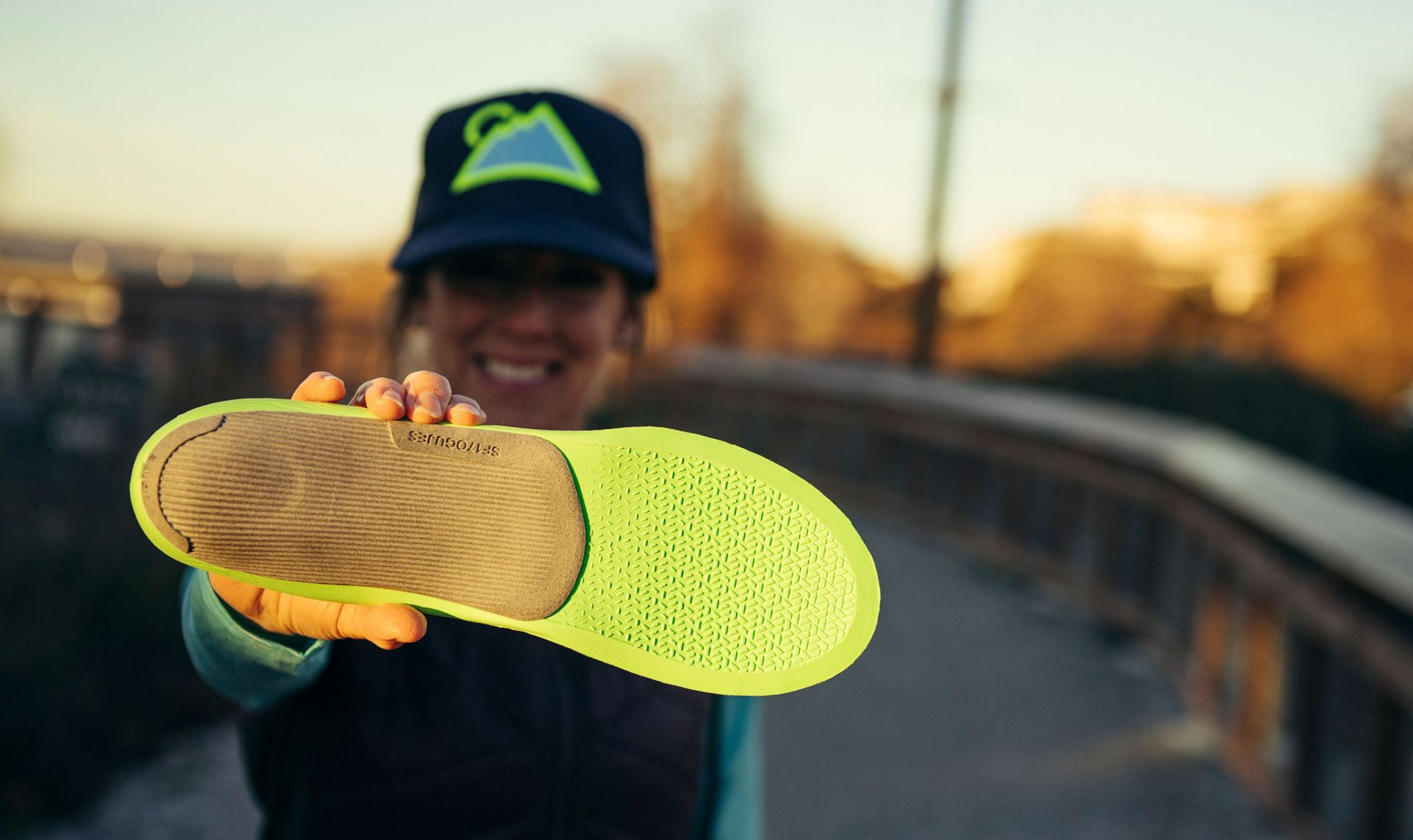 A woman holding a Superfeet ME3D insole