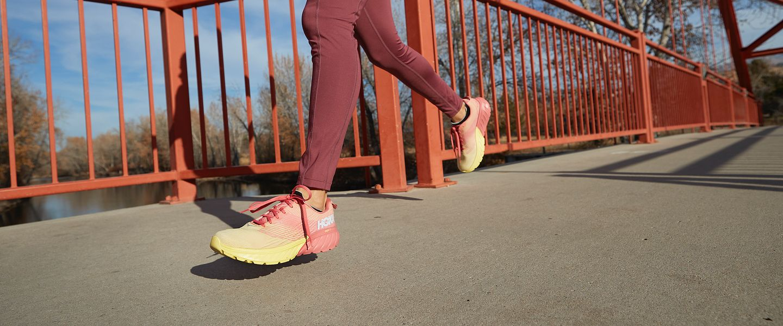 A woman running in the women's HOKA Mach 3 shoes