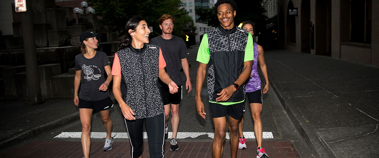 A group of people wearing reflective running apparel from Brooks