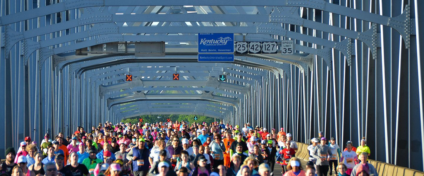 Runners cross over a bridge during the Flying Pig Marathon.