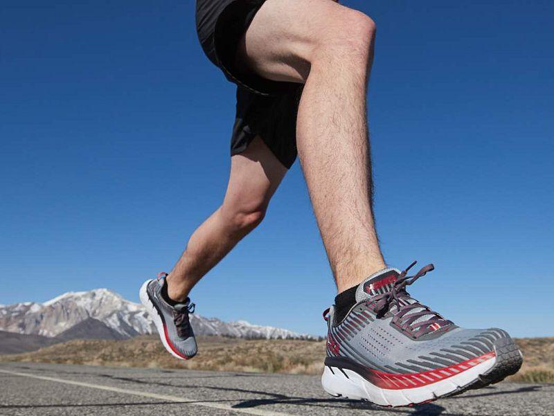 A runner wearing HOKA ONE ONE running shoes