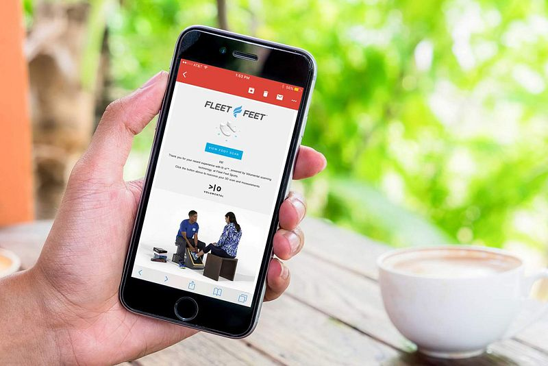 A smartphone with the Fleet Feet website pulled up
